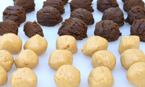 Peanut butter filling and chocolate cookie dough balls, part of prep for cookies